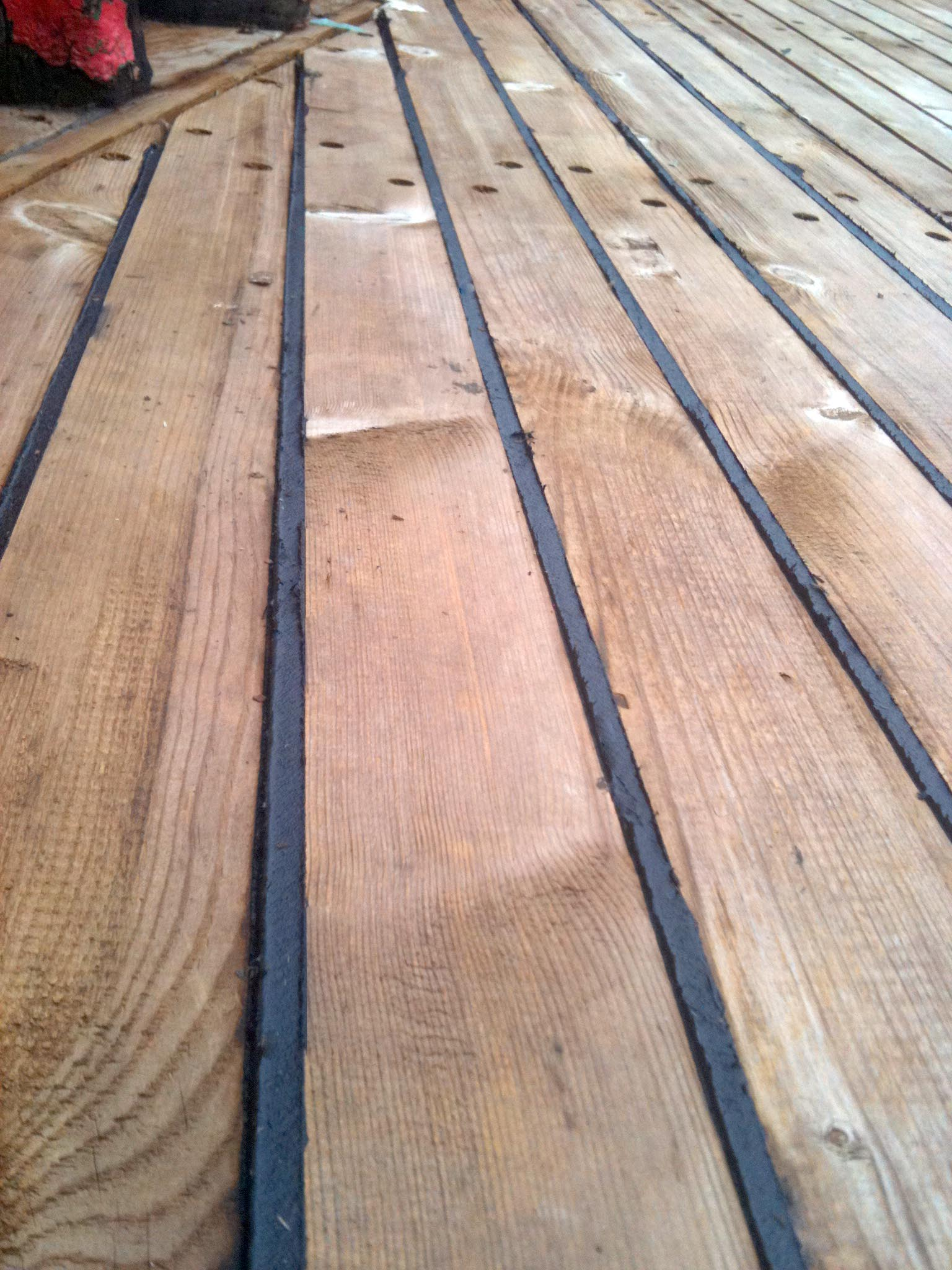 More deck caulking hull caulking and seam paying caulking a wooden deck and sealing deck seams on a wooden boat baanklon Gallery