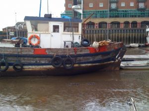 Fifie Zulu Pansy Fishing boat sat in the mud