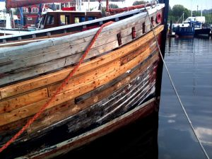 Repairing wooden hull planks on scottish MFV