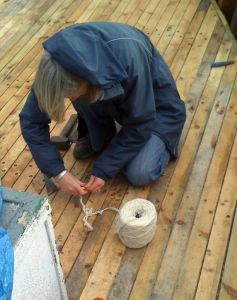 Cotton caulking wooden deck seam repairs on converted MFV