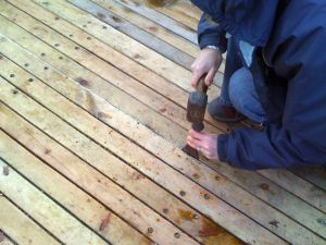 using caulking irons to caulk wooden deck seam repairs on Zulu herring drifter