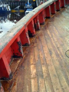 Wooden deck repair caulking and cover boards