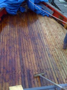 oiled wooden boat deck prior to caulking