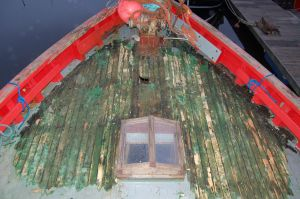 stripping the deck of an old scottish mfv houseboat conversion